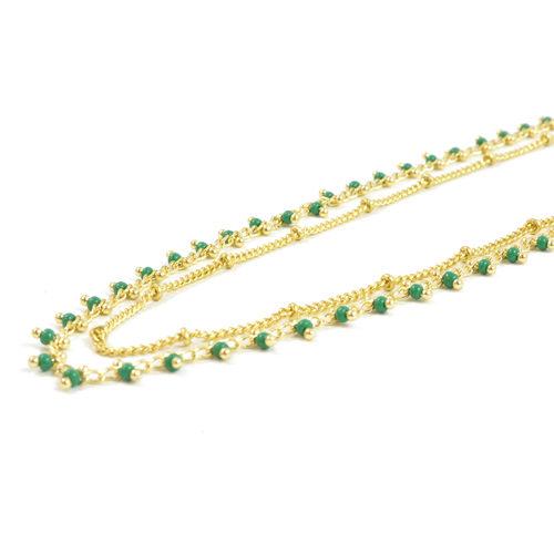 bracelet double chaine en acier inoxydable or vert sur fond blanc