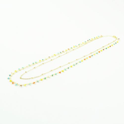 bracelet double chaine en acier inoxydable or multicolore sur fond blanc