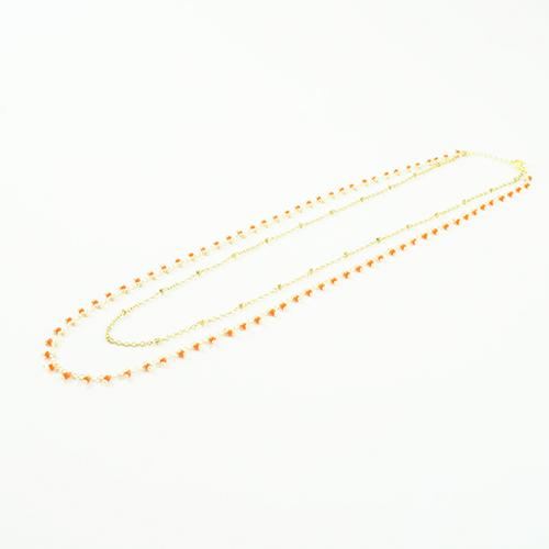 bracelet double chaine en acier inoxydable or orange sur fond blanc