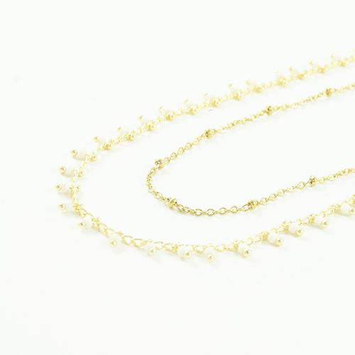 bracelet double chaine en acier inoxydable or jaune sur fond blanc